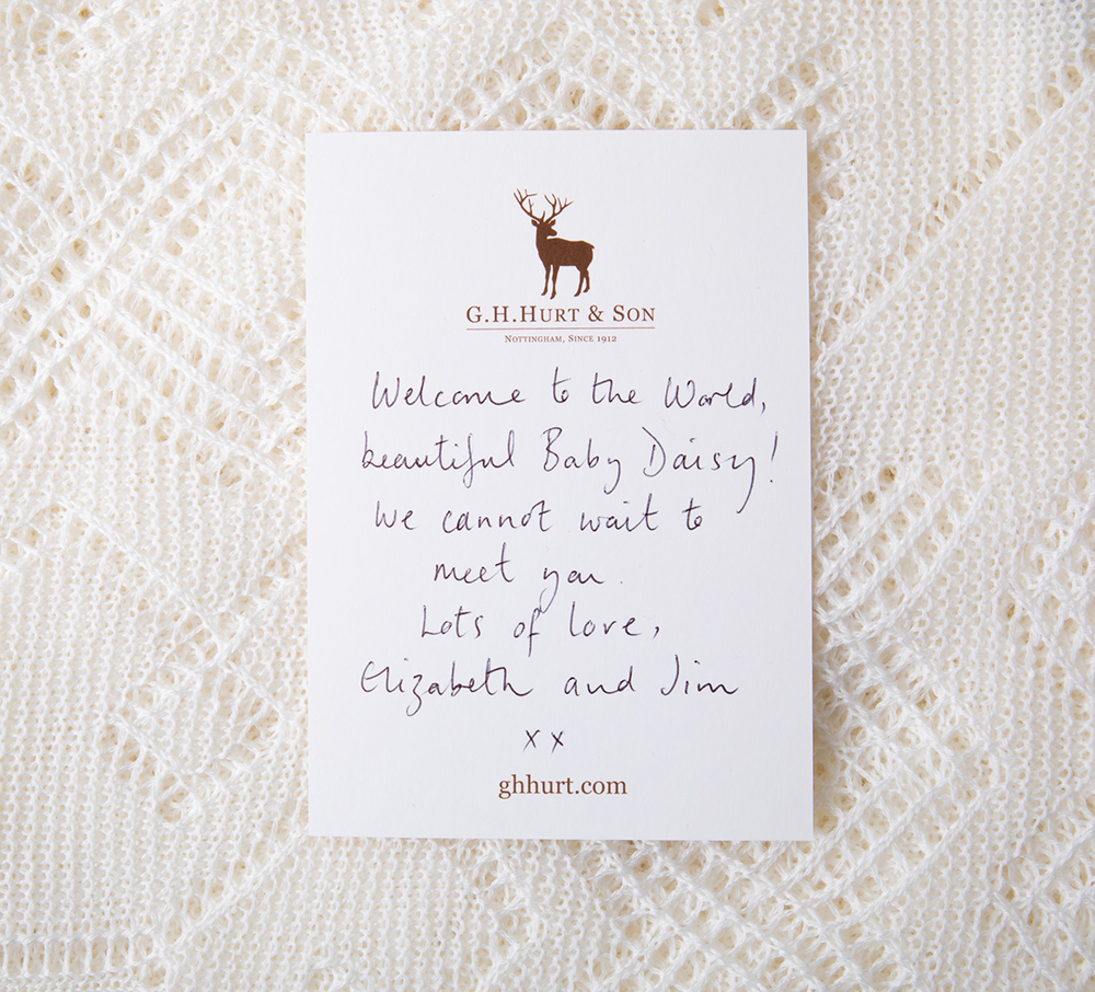 Hand written gift card with baby shawl