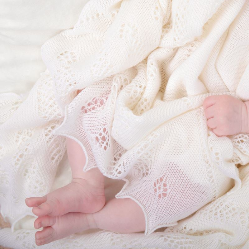 baby feet in nottingham lace knitted shawl