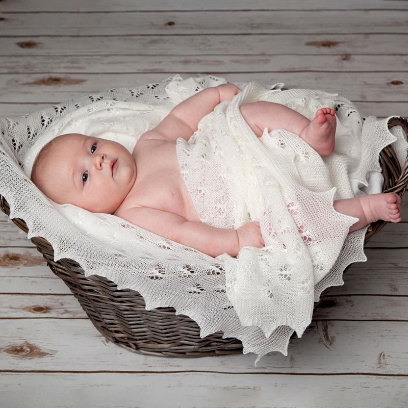 baby in basket with butterfly shawl