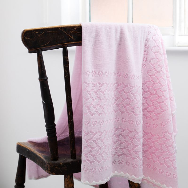 pink leaves and flowers shawl folded on chair