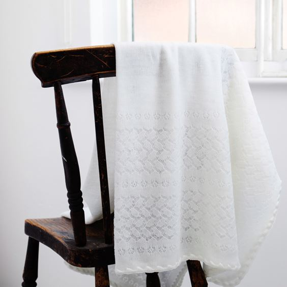 White leaves and flowers shawl folded on chair