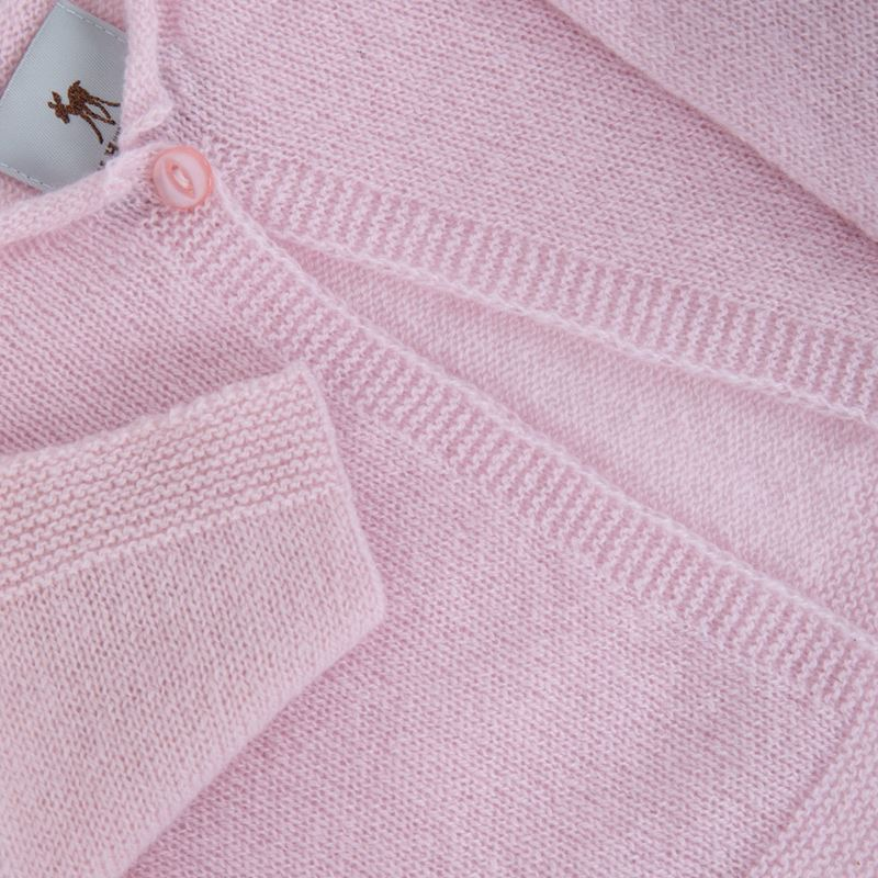 Pink cashmere baby cardigan folded